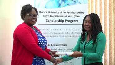 Ms. Dericia Bryant (R) Receives MUA Scholarship